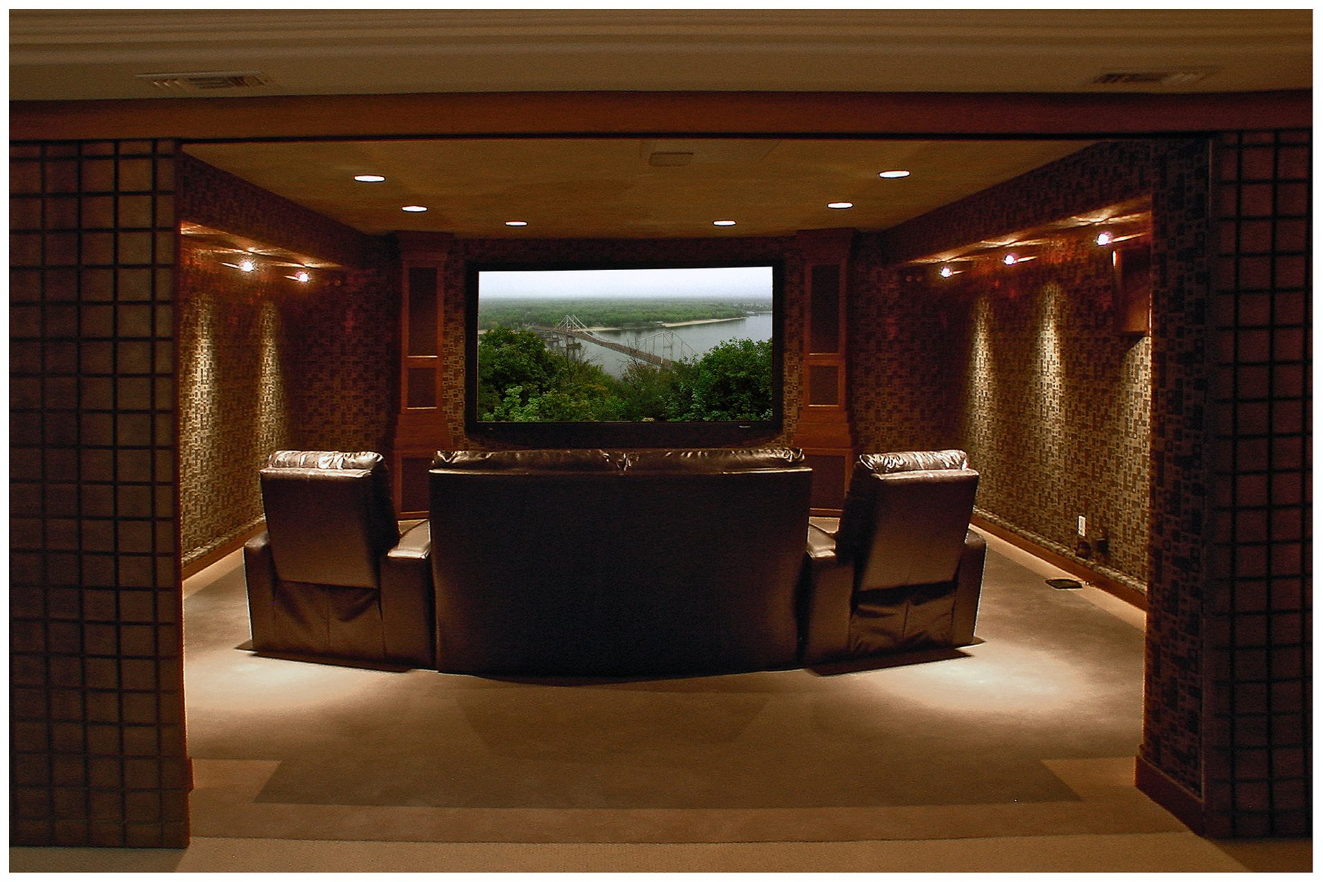 SMALL THEATER IN A DEDICATED ROOMThe before and after pictures above illustrate transformation of a relatively small spare storage space in a basement into a high-end small theater.  Room's ceiling height of only eight feet limited seating to only one row. The four-seat theater however suited well the family of three.