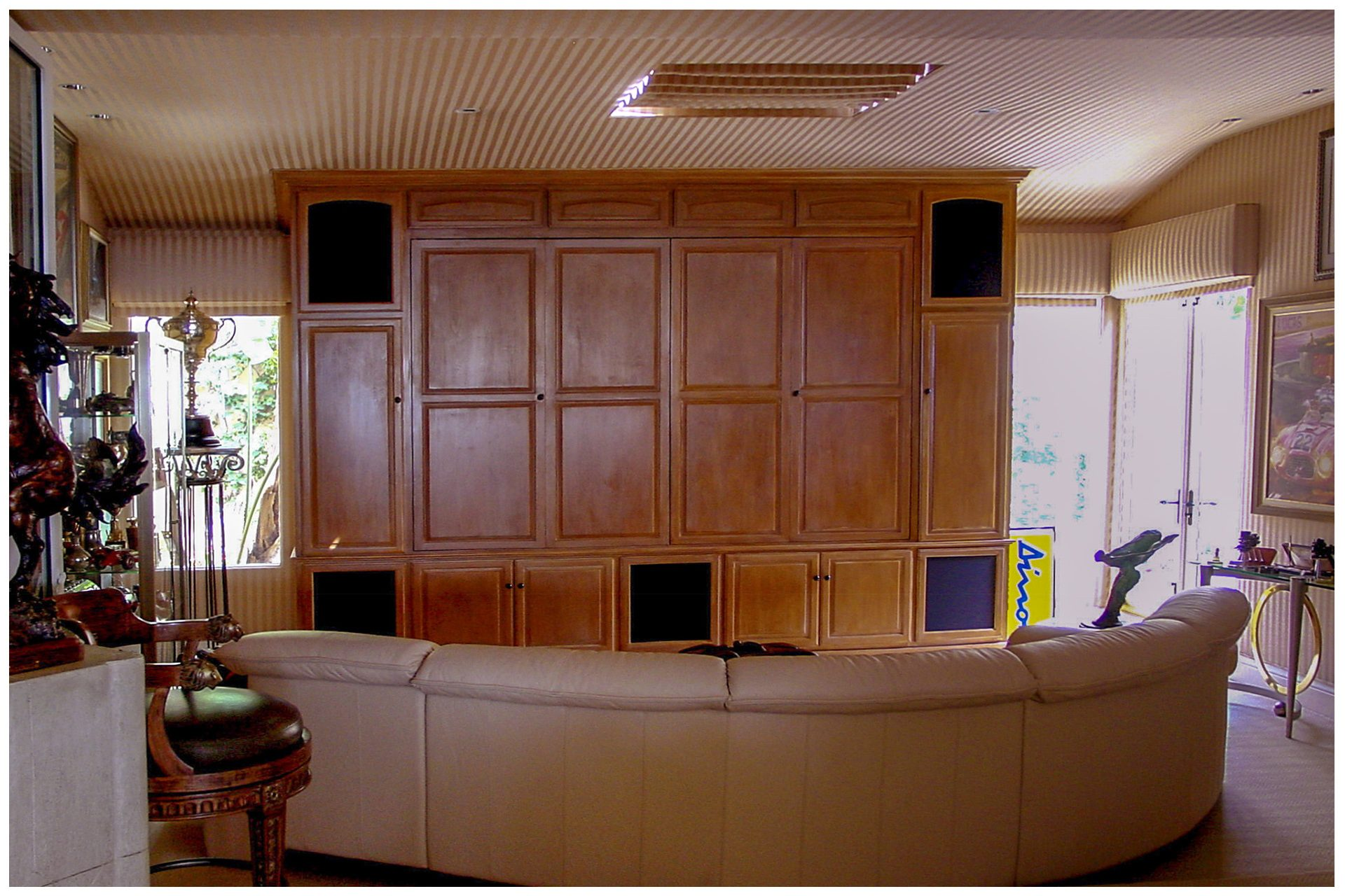 SMALL DEN THEATER All speaker elements were enclosed in the cabinet.  The projector was recessed into the ceiling.The cabinet was designed with space and wiring provisions to accommodate a future upgrade to a large LED screen behind a drop down screen for daytime viewing.